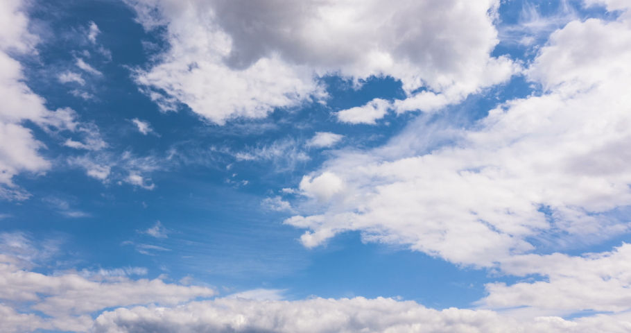 Beautiful blue sky with clouds background. Sky clouds. Sky with clouds weather nature cloud blue. Blue sky with clouds and sun. Loop.