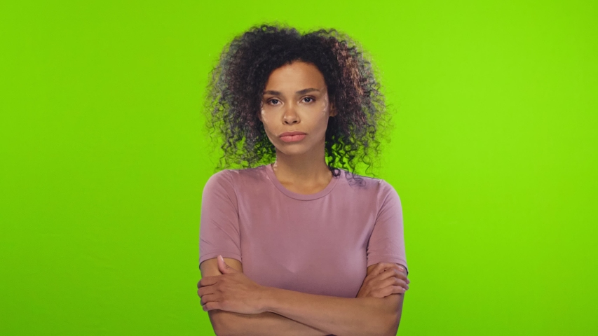 Puzzled hesitant African American female with curly hairstyle, shrugs shoulders as doesn't know the answer or can`t make a decision, how to change future life. Life perception and attitude concept. Royalty-Free Stock Footage #1033867370