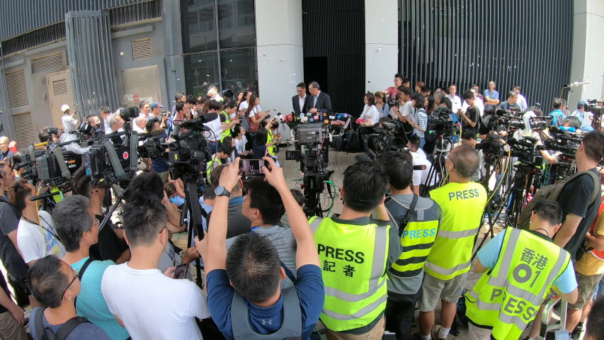 HONG KONG – 2 JULY 2019: Crowds of camera crews and reporters listen to speech of Andrew Leung, President of the Hong Kong Legislative Council, one day after the parliament was ransacked by protesters