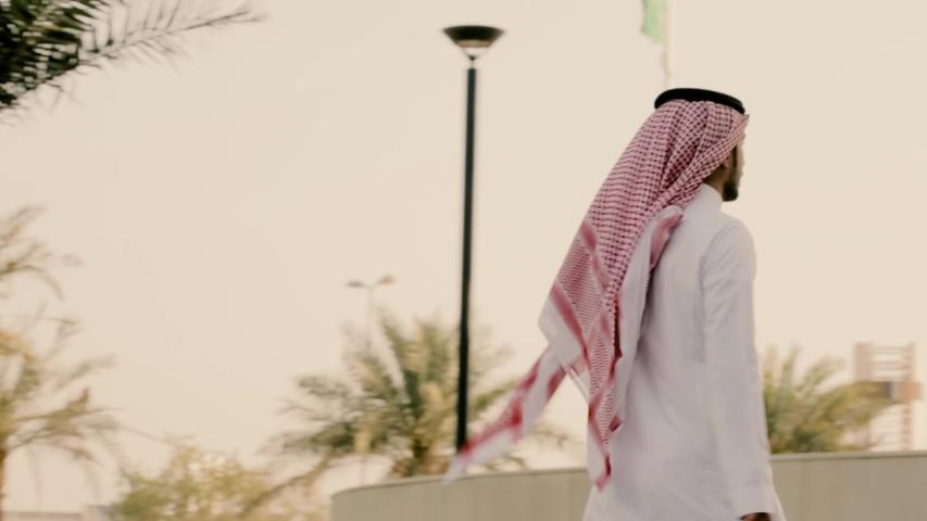 Saudi man walking in a beautiful place | Shutterstock HD Video #1033875155