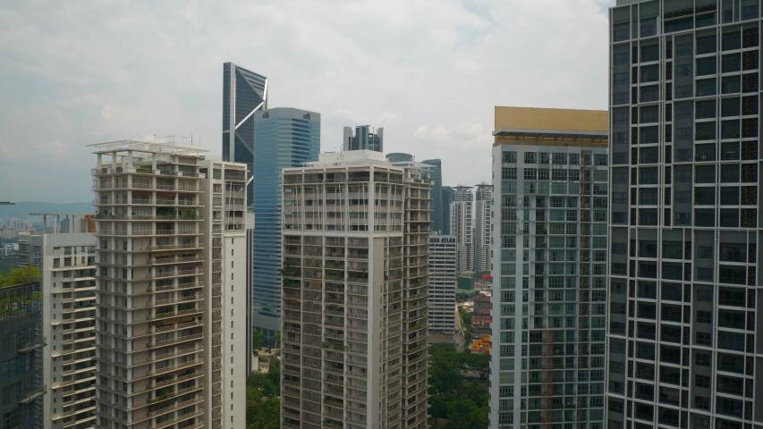 KUALA LUMPUR, MALAYSIA - OCTOBER 1 2018: sunny day kuala lumpur downtown apartment building front rooftop panorama 4k circa october 1 2018 kuala lumpur, malaysia. | Shutterstock HD Video #1033879400