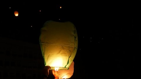 Single Fire Lantern Starting To Fly To The Sky. Fire Lantern Launching Close Up.