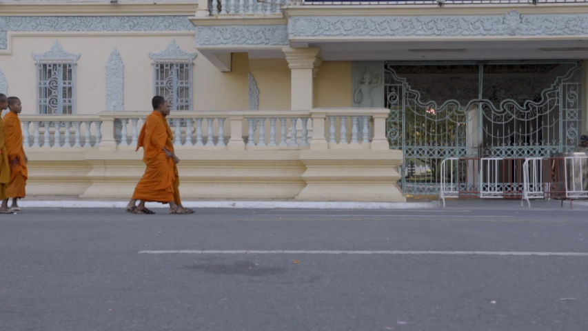 phnom penh, kandal / Cambodia - 02 06 2017: Slow motion of monks walking around the Royal Palace area of Phnom Penh, Cambodia.