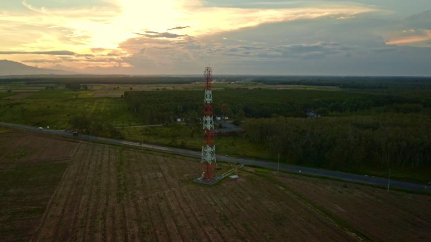 Orbit Aerial Shot of Telecommunication Transmitter Tower at Village | Shutterstock HD Video #1033918757