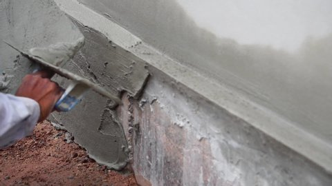 Construction worker finishing a wall fooage slow motion