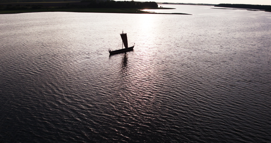 Old viking ship alone in the ocean