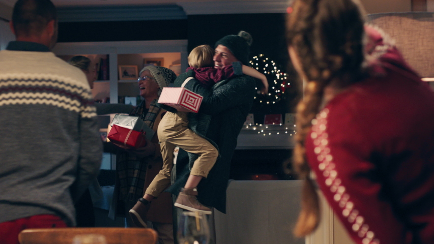 christmas family hugging arriving for dinner party celebrating festive holiday reunion with friends enjoying season greeting at home 4k footage