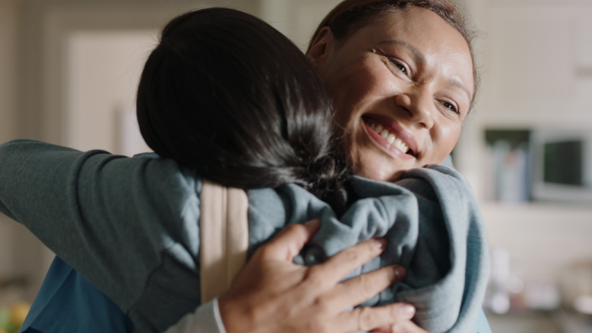 mother getting ready for work packing daughters lunch teenage girl going to school hugging mom goodbye happy family household 4k #1033934888