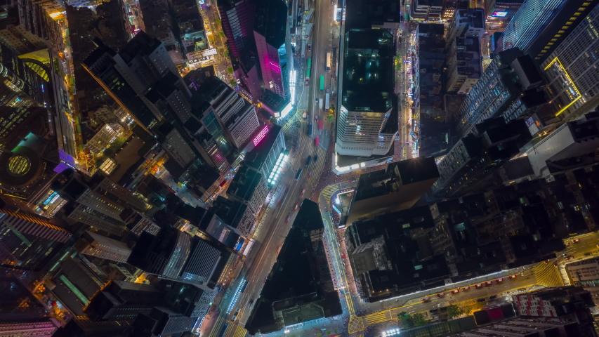 hong kong city night time illuminated famous traffic street district aerial topdown panorama 4k timelapse #1033954064
