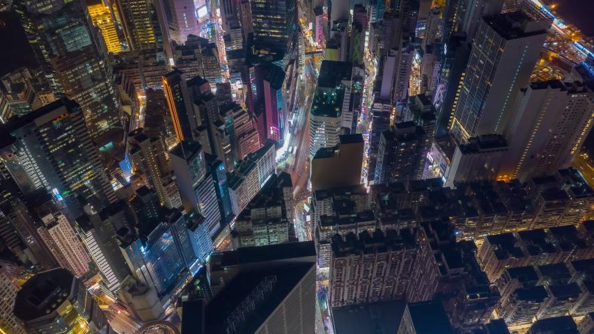 Night illumination flight over hong kong city downtown traffic aerial topdown panorama 4k timelapse | Shutterstock HD Video #1033954124