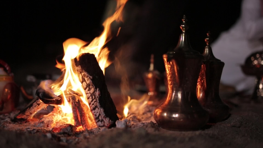 fire place in desert Bedouin environment with dallah and tea at night