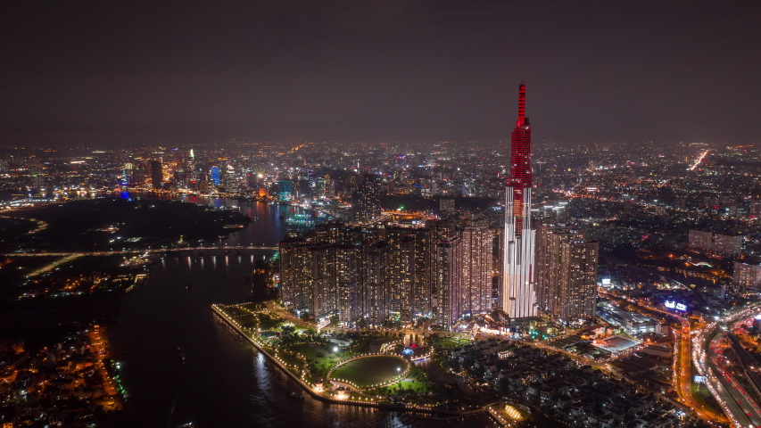 Ho Chi Minh City, Vietnam - November 6, 2018 : Aerial Hyperlapse of Landmark 81 and Ho Chi Minh City at night