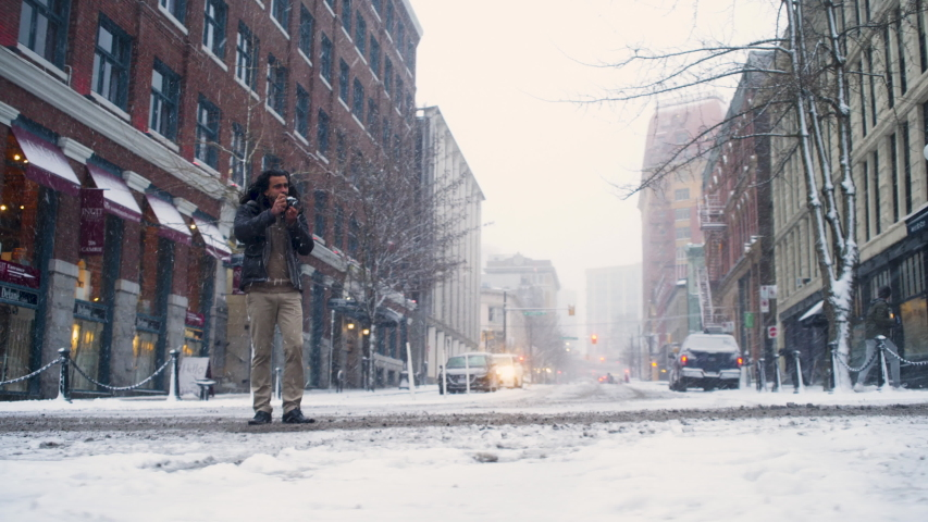 Vancouver, British Columbia / Canada - 02 10 2019: British Columbia, Vancouver, February 2019 - A Man Takes Pictures of Steam Clock in Gastown During Snowfall   Shutterstock HD Video #1033973198
