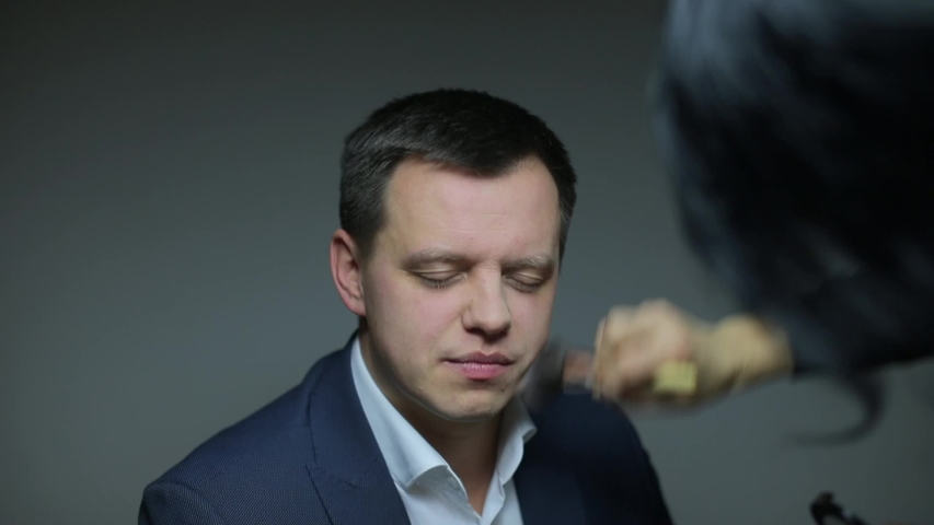 Applying make-up on a man's face | Shutterstock HD Video #1033984307