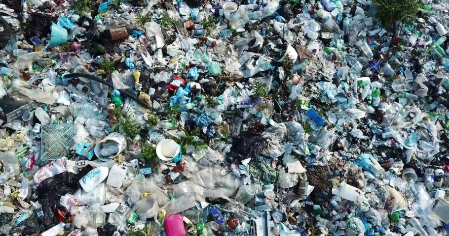 Plastic in the mountains, Mountain garbage, large garbage pile, degraded garbage. Pile of stink and toxic residue. These garbage come from urban areas, industrial areas. Consumer society Cause massive
