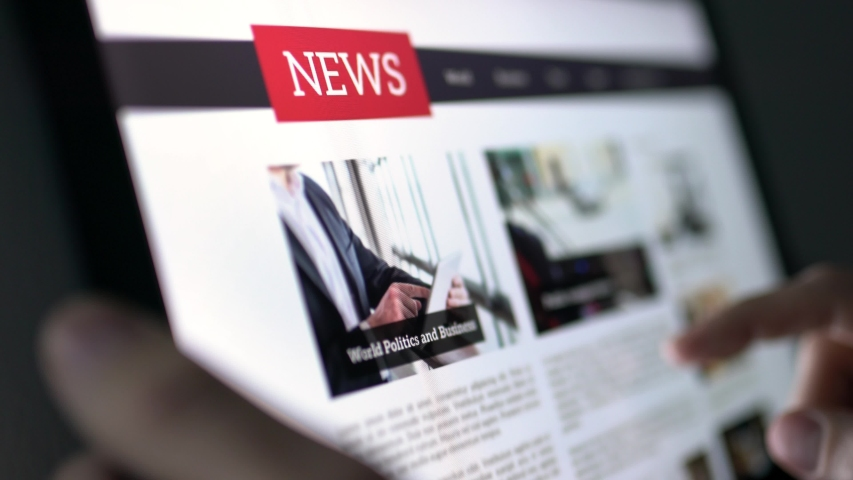 Online news article on tablet screen. Electronic newspaper or magazine. Latest daily press and media. Mockup of digital portal and website. Happy person using web service in the morning. Reading text. Royalty-Free Stock Footage #1034001848