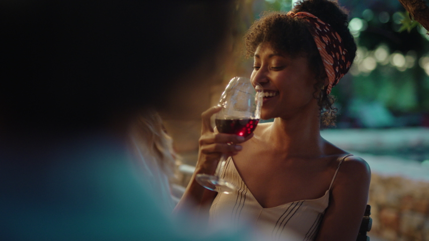Beautiful african american woman enjoying dinner date flirting with man couple drinking wine making toast celebrating romantic evening together 4k | Shutterstock HD Video #1034005010