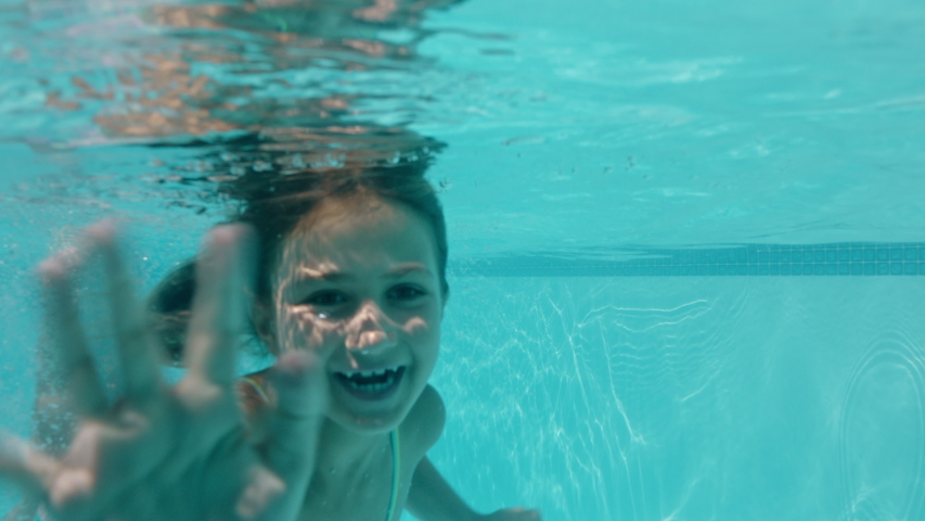 Little Girls In Swimming Pool Stock Photo - Download Image