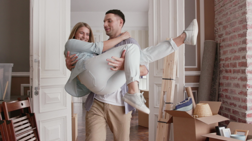 Family or Lovers Move in Modern Real Estate. Positive Looking at Newlyweds Relocate. Enjoy Female Marriage Life or Casual Friendship Inside Cozy Flat. Unpacking Furniture or Package after Dream Sale #1034046776