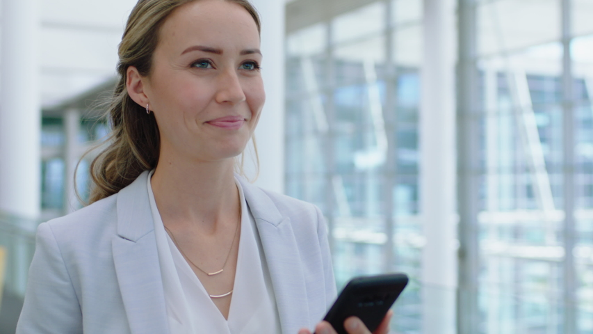 beautiful business woman using smartphone texting walking in corporate office typing text messages on mobile phone checking emails successful female executive at work 4k footage Royalty-Free Stock Footage #1034048405