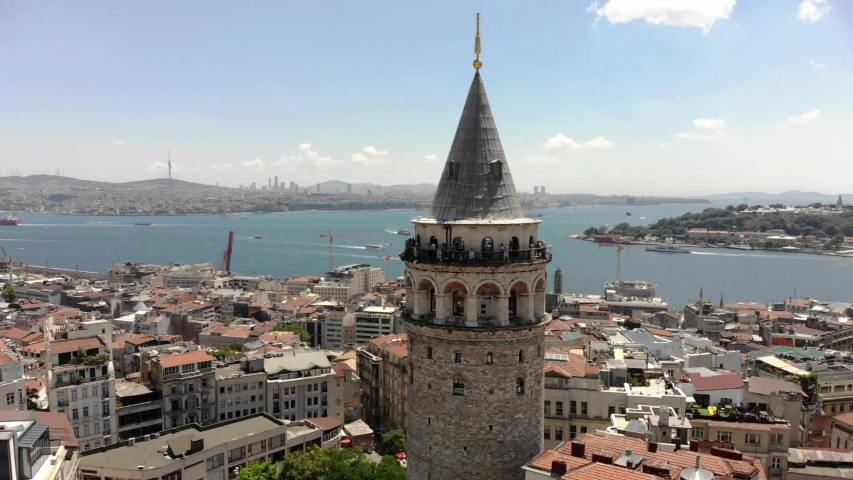 Aerial view of Galata tower, one of the ancient symbols in Istanbul. Bosphorus and Istanbul skyline. Istanbul, Turkey. Shot from a drone.