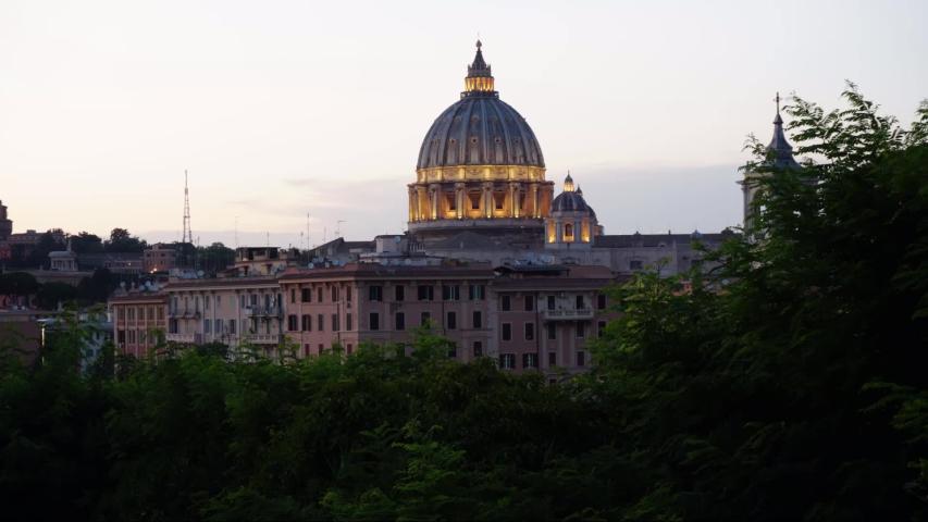 Timelapse of sun setting on St Peter's Basilica, Vatican City. | Shutterstock HD Video #1034054750