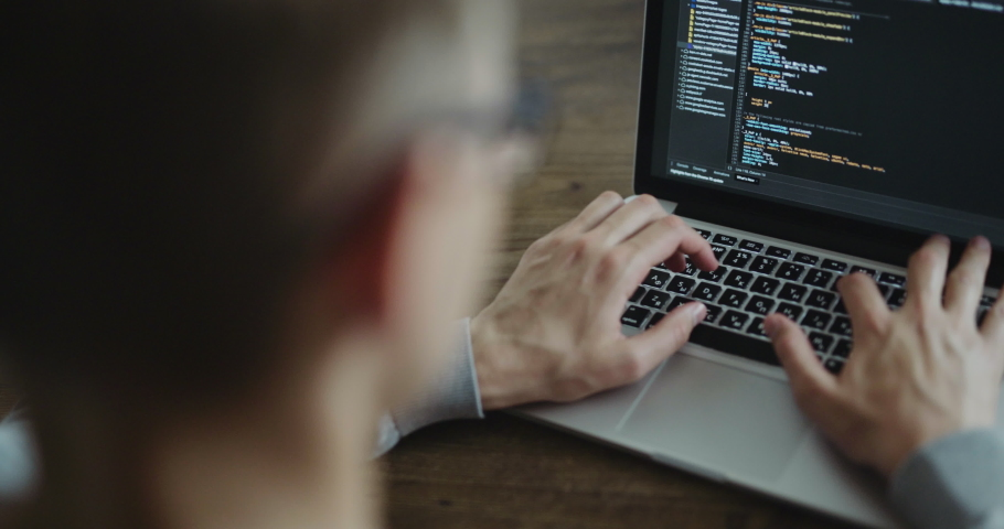 Web developer working at the computer | Shutterstock HD Video #1034071172