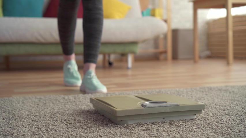 Weight control concept,women's feet on the floor scales