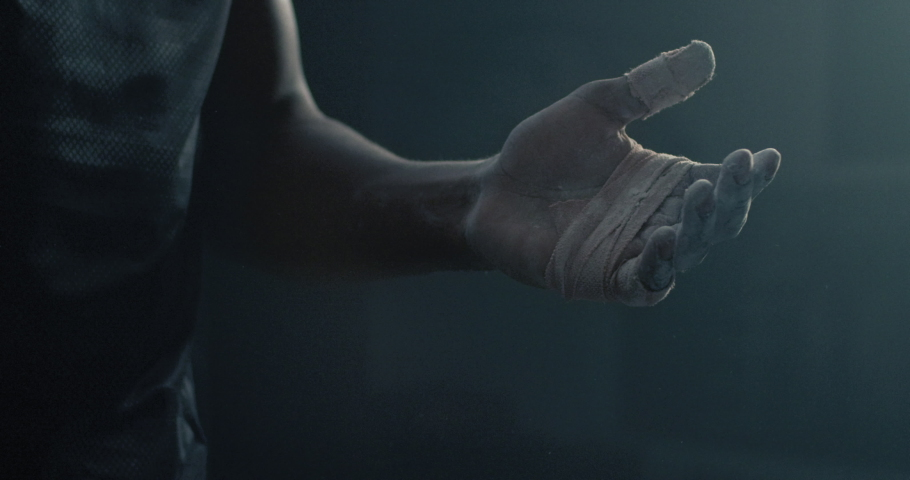 Fitness man athlete hands clapping chalk powder sportsman preparing training workout in gym ready for bodybuilding strength exercise slow motion close up | Shutterstock HD Video #1034107763