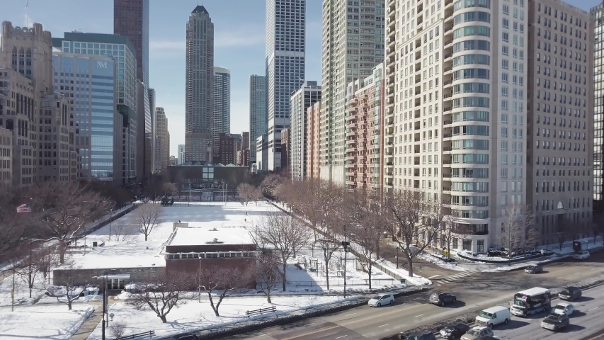 Aerial view of Chicago Downtown In Winter next to frozen lake Michigan