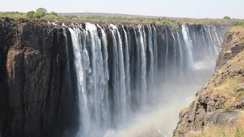 Magnificent Victoria Falls in Simbabwe with rainbox during dry season