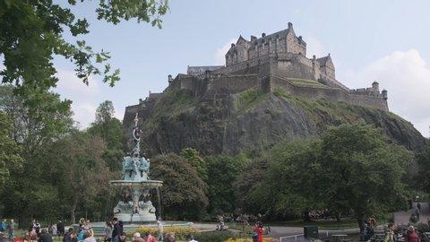 Edinburgh, Scotland / United Kingdom - June 2nd 2019: Ross fountain in Princes Street Gardens in front of Edinburgh Castle