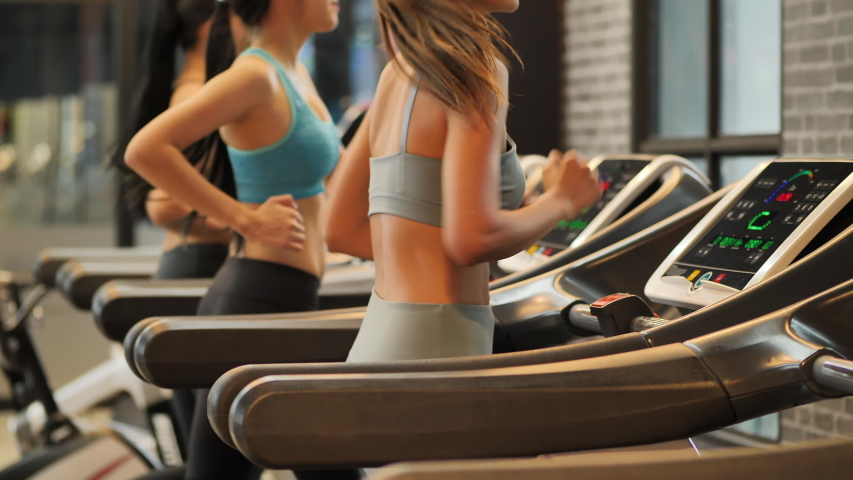 Group of Young woman running on a treadmill at gym. Fitness and healthy lifestyle concept.  Slow motion | Shutterstock HD Video #1034135741