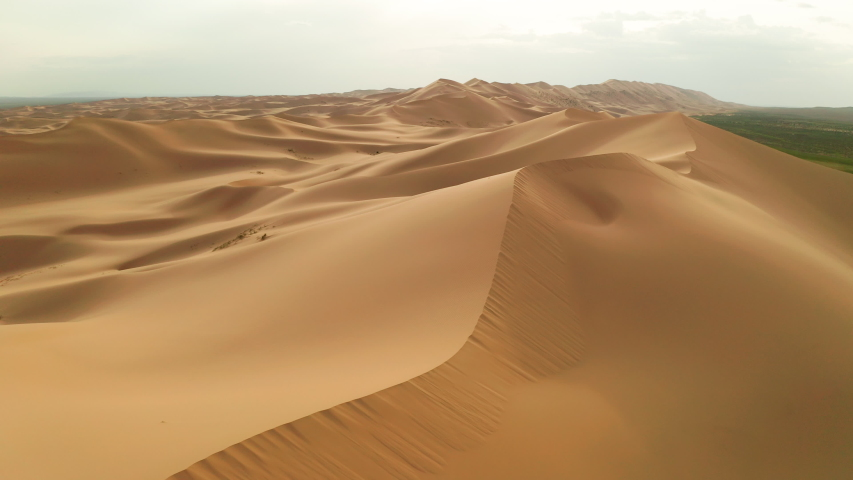 Sunset over the sand dunes in the desert | Shutterstock HD Video #1034138555