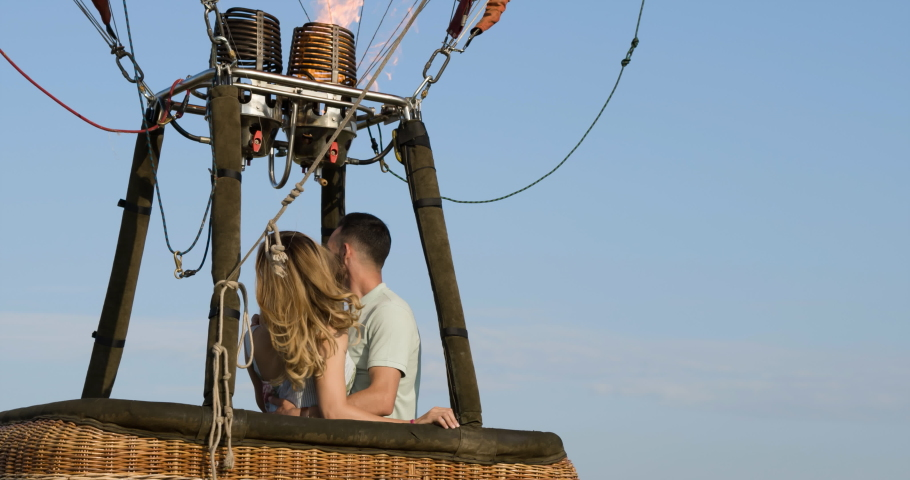 on Air Balloon Couple Hugging in Basket closeup Aerial view 4K video.