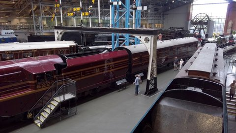 York, Yorkshire UK - July 23 2019 : Pan over the preserved railway transport exhibits at the National Railway Museum in York North Yorkshire England.