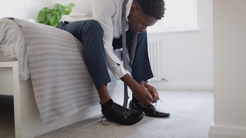 Business Couple In Bedroom Getting Ready For Work Businesswoman At Home Putting On Shoes