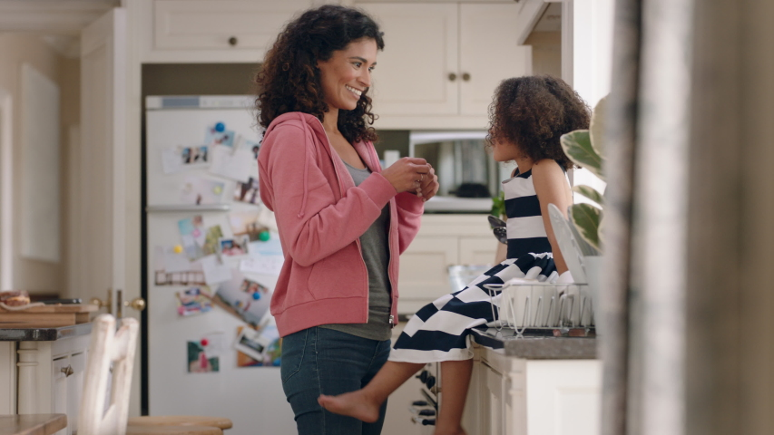 mother applying band aid to little girls knee caring for her child at home happy kid enjoying motherly love
