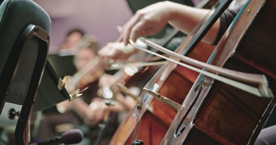 Musician playing Cello during a classical music rehearsal before a concert | Shutterstock HD Video #1034188133