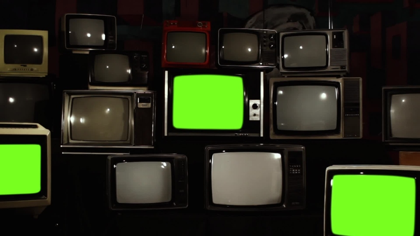 "Retro Televisions Turning On Green Screen. Zoom In. You can replace green screen with the footage or picture you want with ""Keying"" effect in AE (check out tutorials on Internet). 