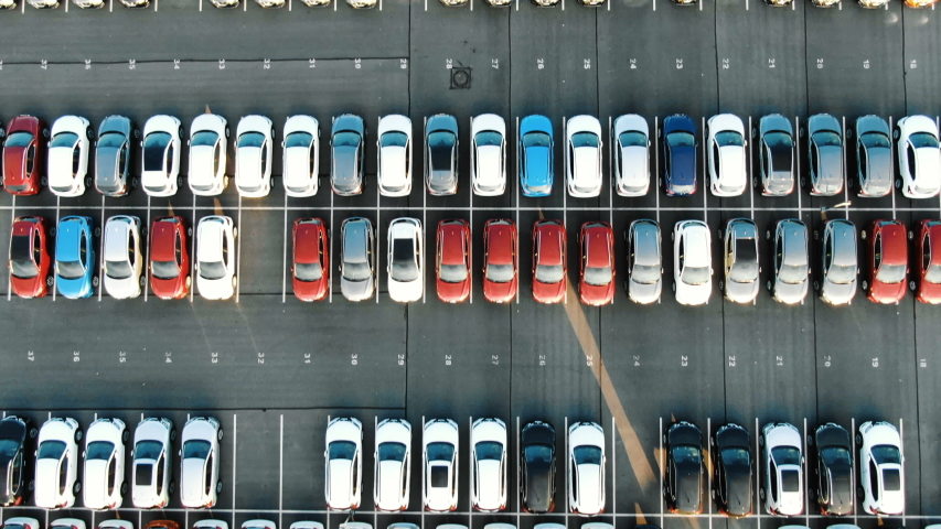 Coloured vehicle rows on storage area with white marking | Shutterstock HD Video #1034199311