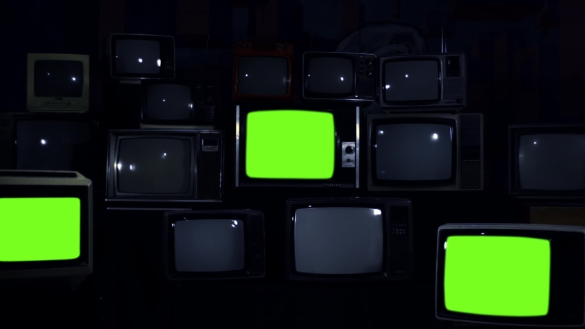 "Retro Televisions Turning On Green Screen. Blue Dark Tone. Zoom In. You can replace green screen with the footage or picture you want with ""Keying"" effect in AE (check out tutorials on Internet). 