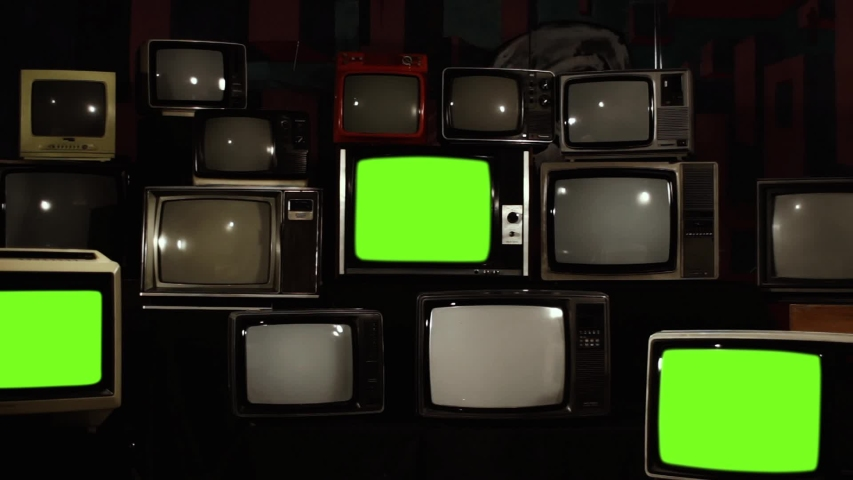 "Three Retro Televisions Turning On Green Screen. High Contrast Tone. Zoom Out. You can replace green screen with the footage or picture you want with ""Keying"" effect in AE (check out tutorials). 