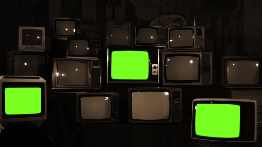"Three Retro Televisions Turning On Green Screen. Sepia Tone. Zoom Out. You can replace green screen with the footage or picture you want with ""Keying"" effect in AE (check out tutorials on Internet). 
