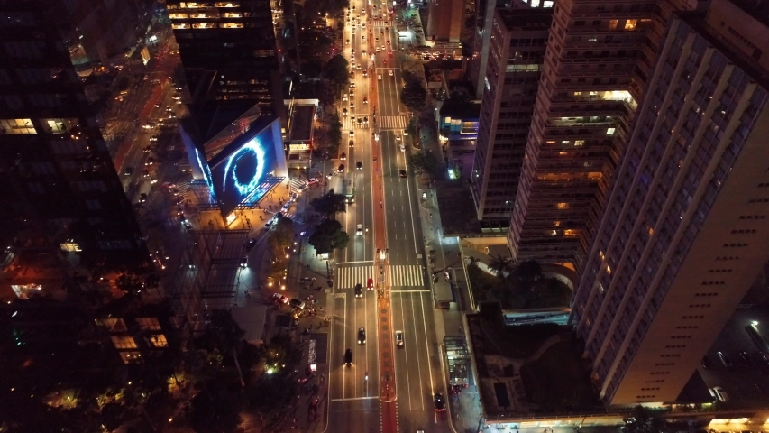 Aerial view of Paulista Avenue, São Paulo, Brazil. Night's scenery. Downtown's scene.  Landmark of the city, Heart of São Paulo. Illuminated avenue. Night scene. City life. Night city. Landscape view