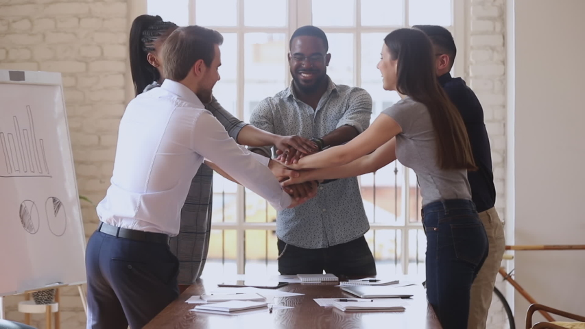 Happy multiracial business team people group stack hands together motivated by corporate success promise partnership union help support in teamwork engaged in teambuilding celebrate victory concept Royalty-Free Stock Footage #1034217707