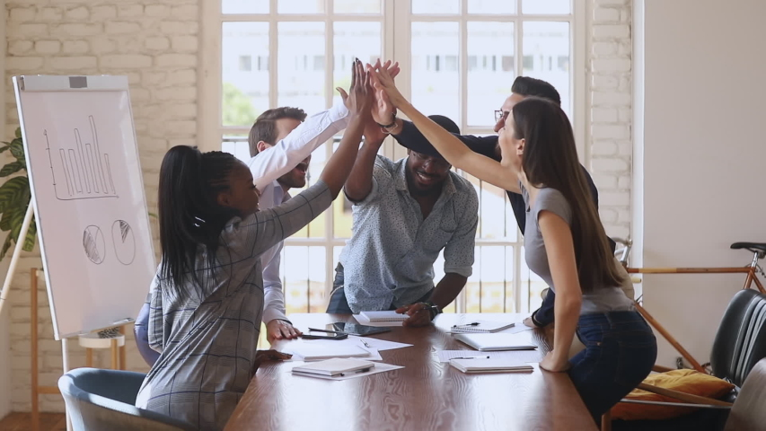 Happy overjoyed business team give high five celebrate successful contract, corporate victory professional triumph good teamwork result profit in financial report sit at office table at group meeting Royalty-Free Stock Footage #1034217716