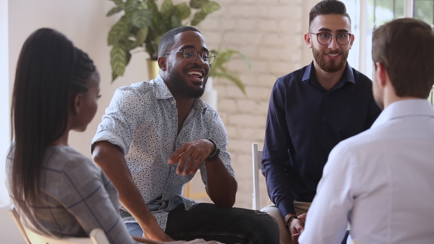African black man drinker talking about alcohol addiction abuse sit in circle speak to diverse addicted people at group therapy session concept share problem in rehab alcoholics anonymous a meeting