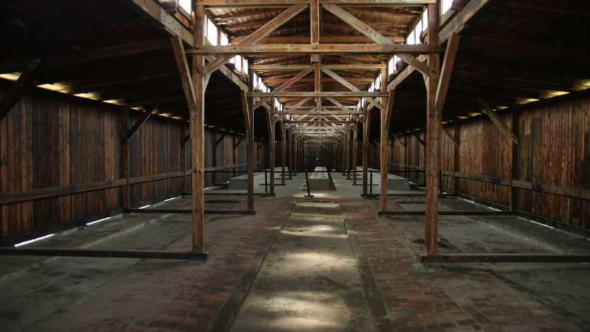 AUSCHWITZ, POLAND - MAY 28, 2019: Barrack view inside concentration camp in Poland Auschwitz Birkenau. Massacres Jews by German Nazis. Place of life of prisoners of genocide. Beds where people slept.