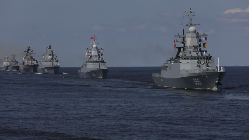 A line of modern russian military naval battleships warships in the row, northern fleet and baltic sea fleet in the open sea, summer sunny day  | Shutterstock HD Video #1034229071
